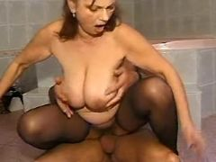 Mature with big tits fucks in bath