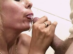 Mature sucks cock and gets facial
