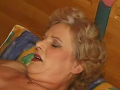 Man licks out plump granny in bed