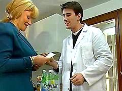 Dirty blond milf blows young doctor