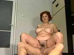 Busty granny cockriding