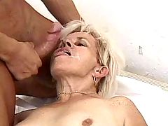 Mature with big tits getting facial