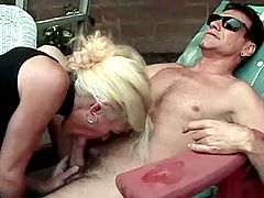 Mature gets cum on ass and in fist